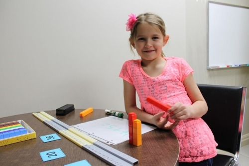 A photo of a young student learning Math at Foundations for Learning