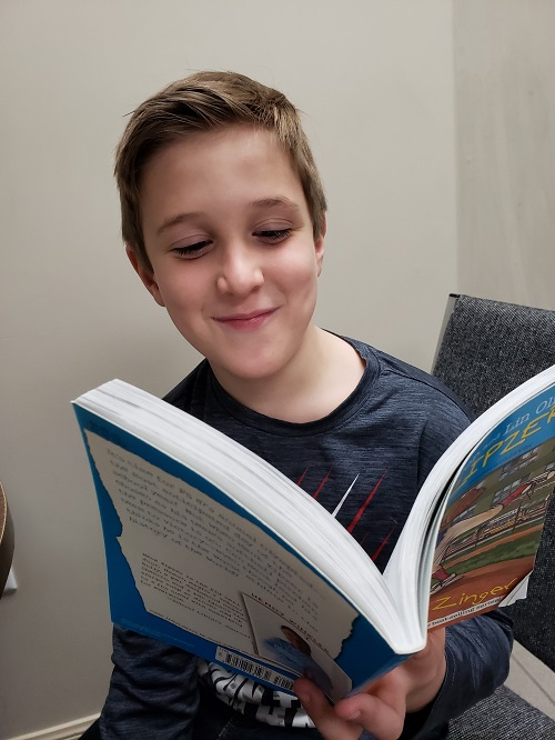 A photo of a young student at Foundations for Learning practicing Language Comprehension and understanding reading, language, and more.